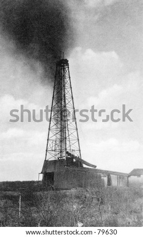 Vintage photo of oil derrick gushing oil - stock photo