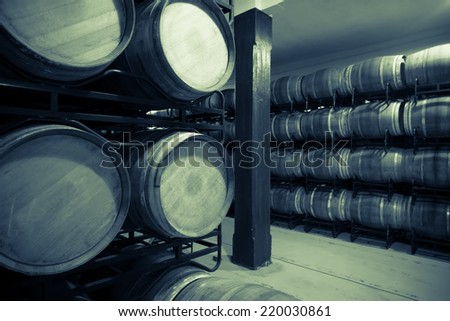 Vintage photo of old wine cellar with  many barrels  - stock photo