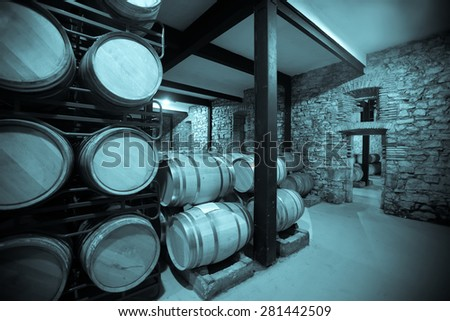 Vintage photo of old winery  with  barrels  - stock photo