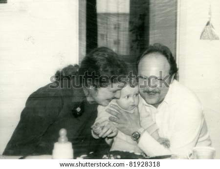 Vintage photo of parents and baby - stock photo