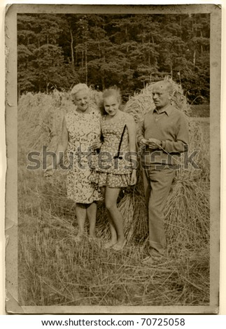Vintage photo of parents and daughter (early sixties) - stock photo