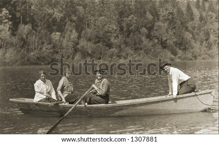 Vintage photo of People In Boat On A River - stock photo