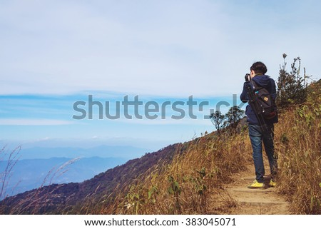 Vintage photo of photographer is taking a picture in mountains
