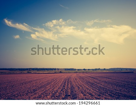 vintage photo of plowed field - stock photo