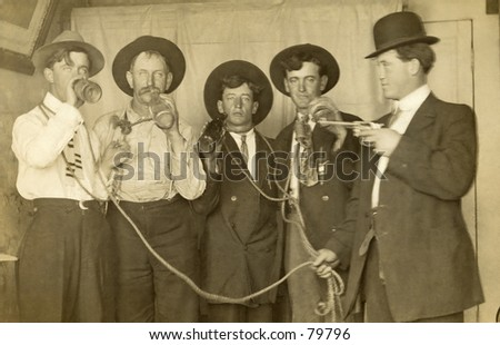 Vintage photo of sheriff arresting four drunks - stock photo