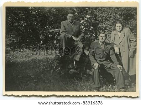 Vintage photo of siblings (1947) - stock photo