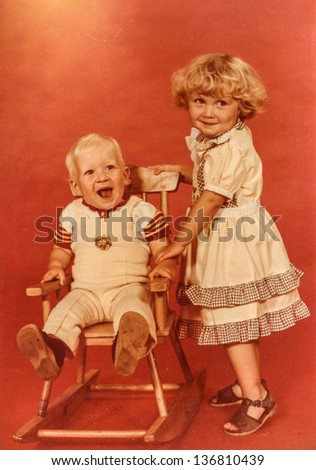 Vintage photo of siblings (early eighties) - stock photo