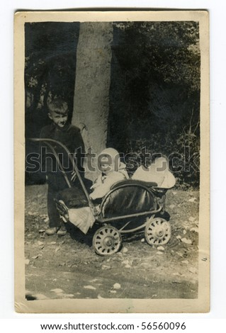 Vintage photo of siblings (fifties) - stock photo