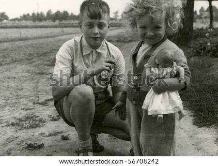 Vintage photo of siblings (fifties) - stock photo