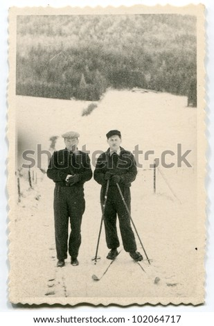 Vintage photo of skier and his friend (fifties)