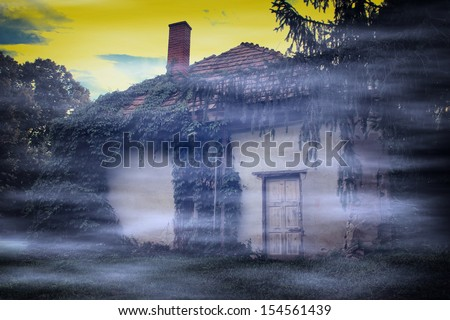 Vintage photo of spooky abandoned house with fog - stock photo