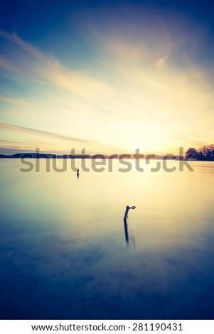 Vintage photo of sunset lake - stock photo