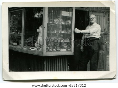 Vintage photo of the owner  of an outdoor newsstand