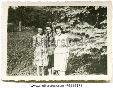Vintage photo of three woman (forties) - stock photo