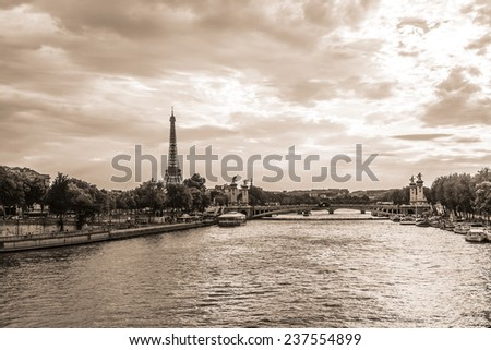 Vintage photo of Tour Eiffel (Eiffel Tower. Eiffel Tower, named after engineer Gustave Eiffel, is tallest structure in Paris and most visited monument in the world. Champ de Mars, Paris France. - stock photo