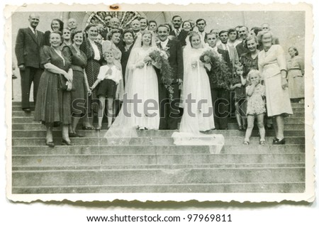 Vintage photo of two couples of newlyweds (forties) - stock photo