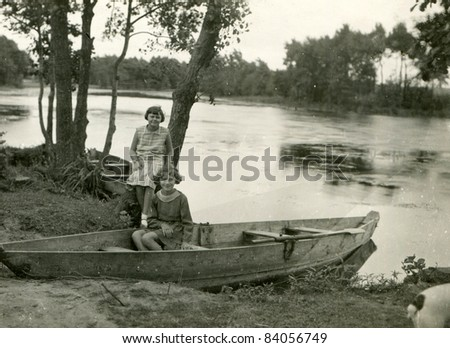 Vintage photo of two girls on riverside (thirties) - stock photo