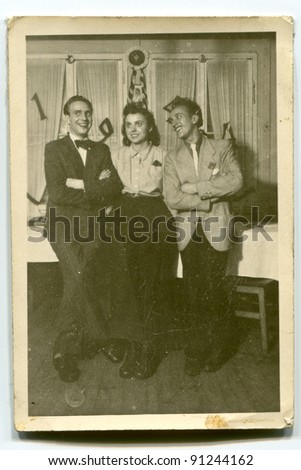 Vintage photo of two men and woman (forties) - stock photo