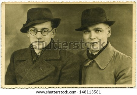 Vintage photo of two men in hats, forties - stock photo