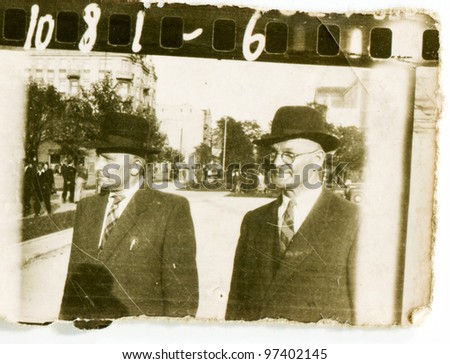 Vintage photo of two men walking (fifties) - stock photo