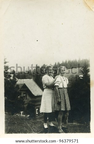 Vintage photo of two sisters (forties)