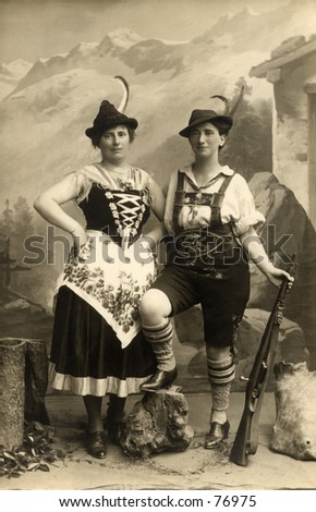 Vintage photo of two women dressed in alpine costumes - stock photo