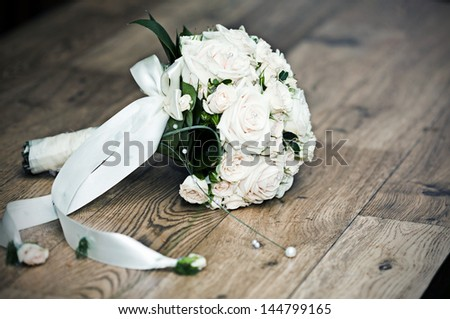 Vintage photo of white wedding bouquet - stock photo