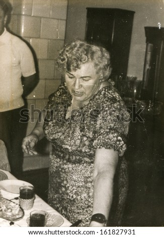 Vintage photo of woman during a family party, seventies - stock photo