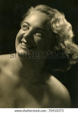 Vintage photo of woman (visible professional retouching) - circa 1950 - stock photo