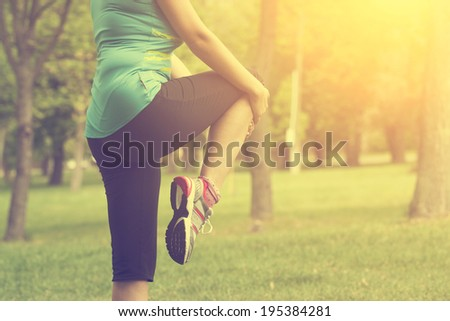 Vintage photo of woman warming up before running