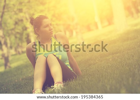 Vintage photo of woman warming up before running - stock photo