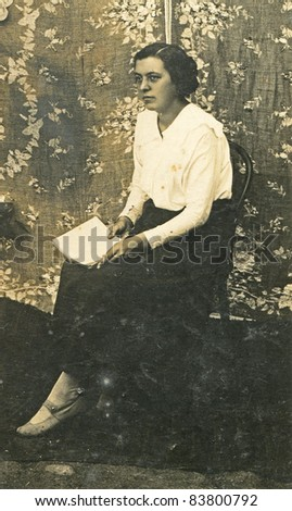 Vintage photo of woman with a book (twenties) - stock photo