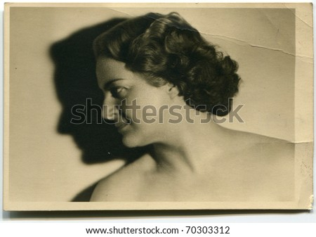 Vintage photo of woman with visible professional retouching - stock photo
