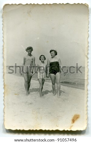 Vintage photo of women and girl on beach (fifties)