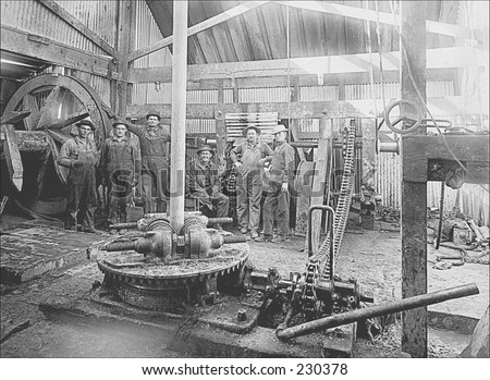 Vintage photo of workers at an oil rig - stock photo