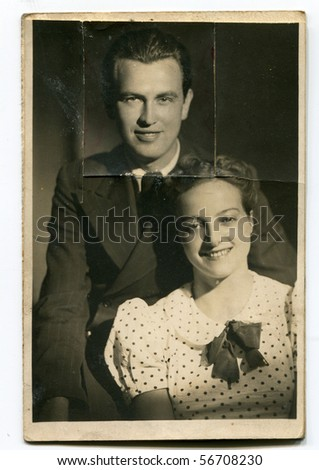 Vintage photo of young couple (cut out after a quarrel) - stock photo