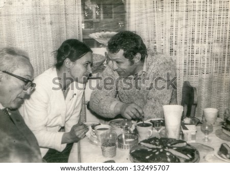 Vintage photo of young couple during a party and elderly father (seventies)