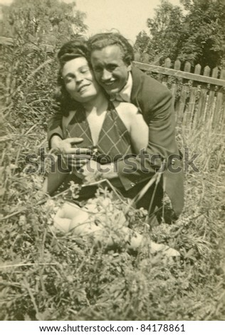 Vintage photo of young couple hugging outdoor (forties) - stock photo