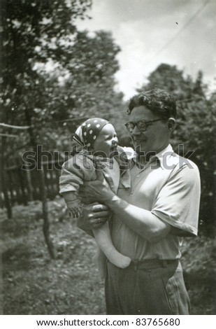 Vintage photo of young father with baby daughter (fifties) - stock photo