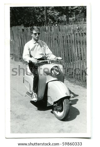 Vintage photo of young man on scooter (fifties/sixties)