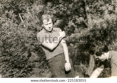 Vintage photo of young man outdoor, sixties - stock photo