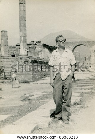 Vintage photo of young man visiting Pompeii (1957) - stock photo