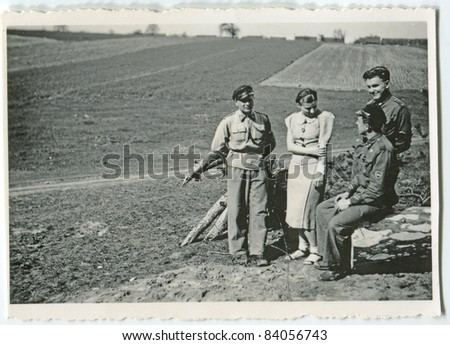 Vintage photo of young people outdoor (thirties) - stock photo