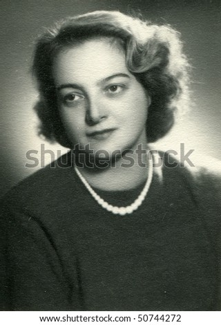 Vintage photo of young woman (1958) - stock photo