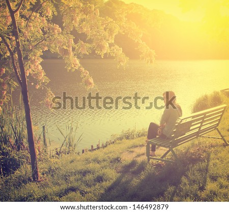 Vintage photo of young woman at the lake - stock photo