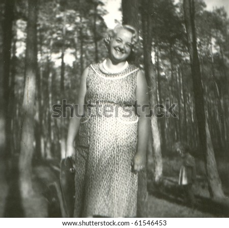 Vintage photo of young woman (early fifties) - stock photo