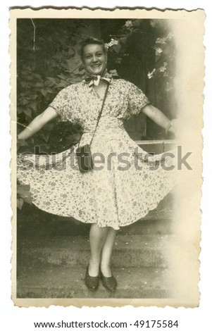 Vintage photo of young woman in dress - stock photo
