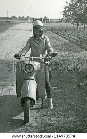 Vintage photo of young woman on scooter (fifties)