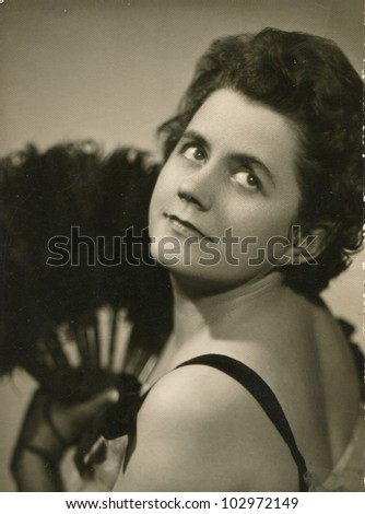 Vintage photo of young woman with fan (sixties) - stock photo