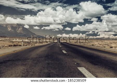 Vintage photo. Road through the desert.  - stock photo